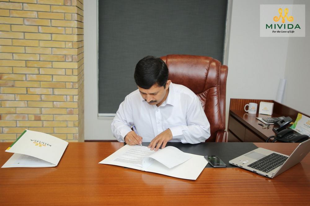 signing ceremony at Mivida office